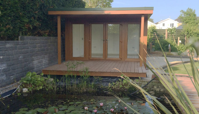 15' x 12' (4550mm x 3640mm) QC6 garden studio with side flyover roof and decking