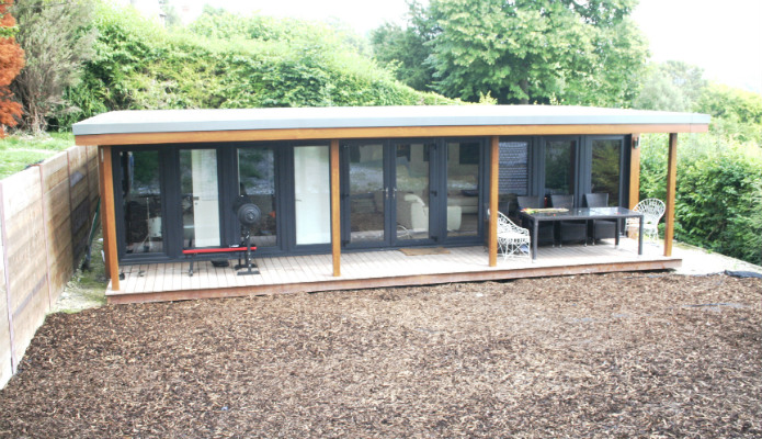 Teenager pad garden room with cinema music room and bathroom for Large garden room