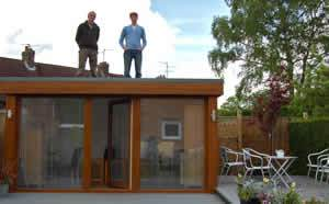 Alex and Iain enjoying the view from the roof of a QC Garden Studio. The Studio could take the weight of 10 men very easily and we now install Sedum Roofs or a Gravel roof if you wish
