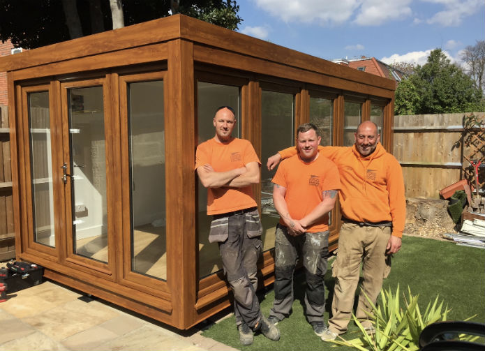 Pix, Dan and Steve in front of the newly installed 16' x 8' QCB garden office
