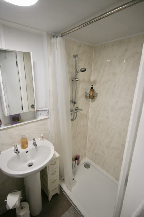 Shower within an L shape granny annexe